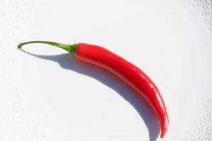 Spezielle Lebensmittel wie die Chili können die Fettverbrennung fördern.